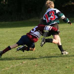 Schoolkids_doing_a_rugby_tackle
