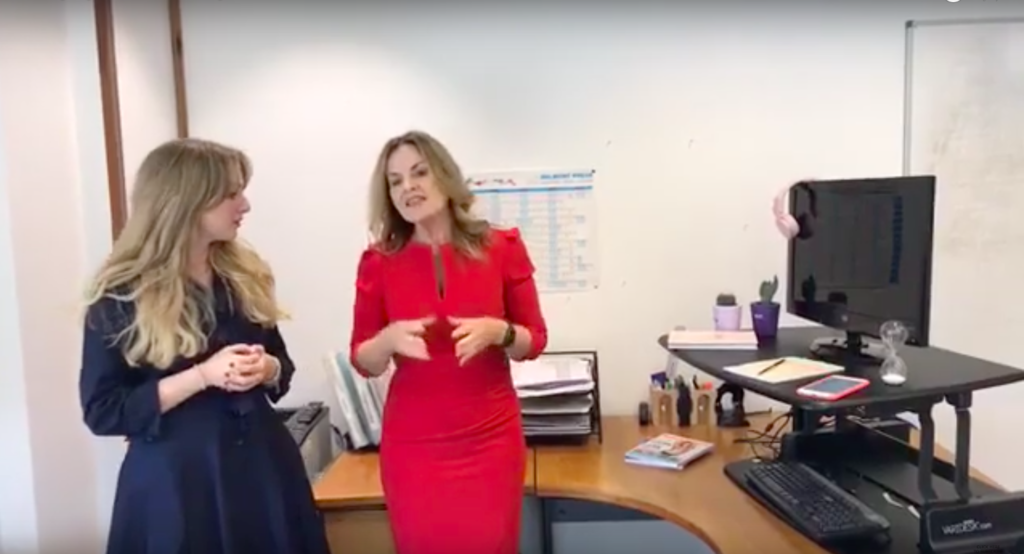 two women talking in an office
